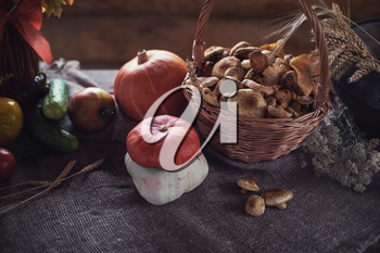 Still life from autumn nature gifts. mushrooms and vegetables