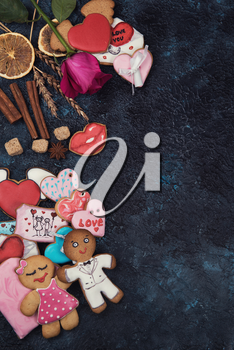 Gingerbreads for love or marrige on dark concrete background