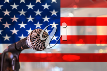 Presentation. or voice concept - microphone on USA flag background.