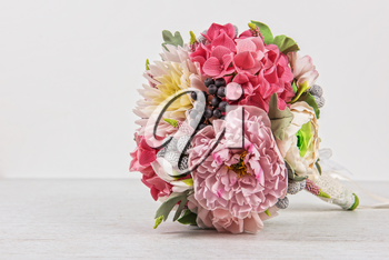 wedding flower composition and rings