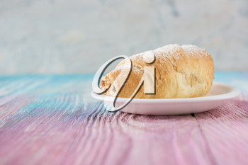 Tasty eclair on a color gradient background