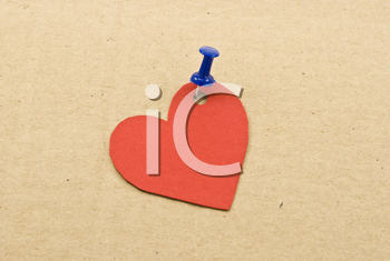 Royalty Free Photo of a Heart Tag on Cardboard