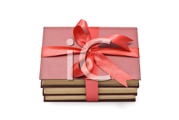 Pile of books with red ribbon and bow