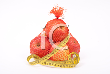 Apples in sack with measure tape