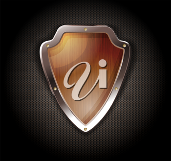 Wooden shield on a metal perforated background