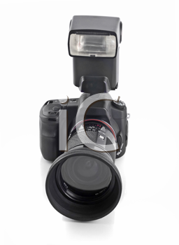 Professional DSLR camera with telephoto lens and flash isolated over white