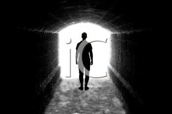 Human silhouette in back lighting in tunnel exit