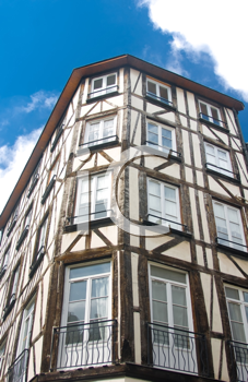 Old Studwork house facade in Rouen, France and blue sky