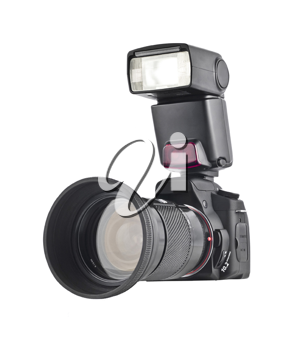 Professional camera with telephoto lens and flash isolated over white