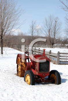Royalty Free Photo of a Vintage Tractor in Snow