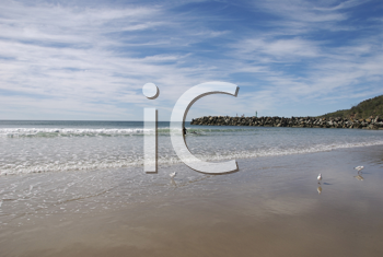Royalty Free Photo of a Person in the Water at the Beach