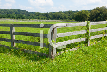 Royalty Free Photo of a Field and Fence