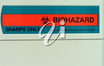 Biohazard label on sharps container in the medical office.