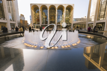 New York City, USA-April 2, 2017: View of Lincoln Center's Revson Fountain, probably the most recognizable destination for visitors and locals.
