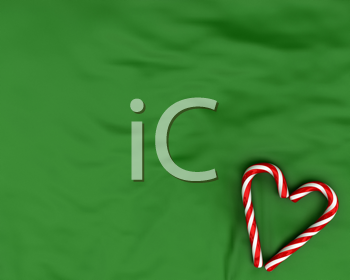 Royalty Free Clipart Image of a Candy Canes in a Heart on a Background