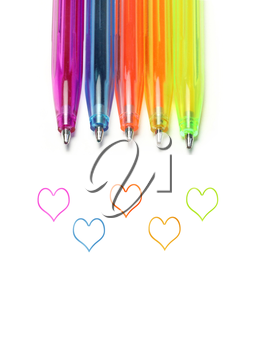 Bright colorful pens and abstract hearts on white background