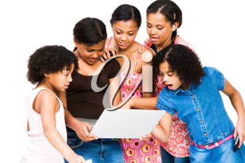 Royalty Free Photo of a Group of Females Looking at a Laptop with Surprise
