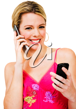 Royalty Free Photo of a Woman Talking on a Mobile Phone and Texting on Another Phone