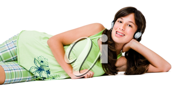 Happy teenage girl wearing headphones and listening to music isolated over white