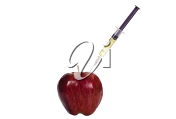 Syringe being injected into an apple