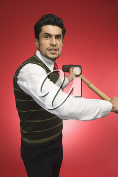 Portrait of a businessman holding a sledgehammer