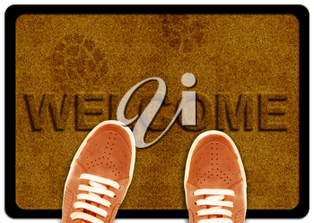 Royalty Free Photo of a Welcome Mat With Shoe Prints and a Pair of Shoes