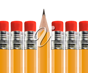 Royalty Free Photo of a Row of Pencils With the Eraser Upright, and one Pencil with the Lead Upright