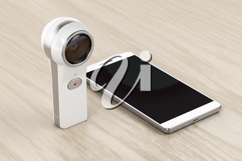 360 degree camera and smartphone on wood background
