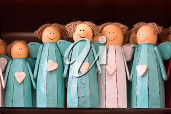 Decorative human figures from wood on the shelf