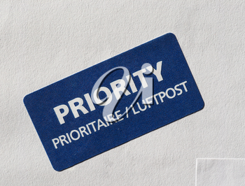 Priority (Prioritaire) mail label tag on a letter for airmail (Luftpost)