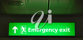 Royalty Free Photo of an Emergency Exit Sign at an International Airport