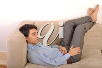 Royalty Free Photo of a Man Sleeping on a Couch