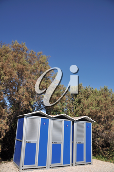 Royalty Free Photo of Blue Portable Toilets