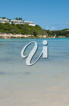 Royalty Free Clipart Image of a Beach in Long Bay, Antigua