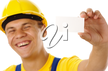 Royalty Free Photo of a Man in a Hardhat Holding a Business Card