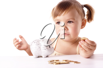 Royalty Free Photo of a Little Girl With a Piggybank