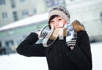 Royalty Free Photo of a Girl in a Snowball Fight