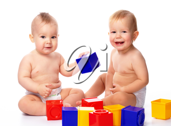 Royalty Free Photo of Two Little Boys Playing With Building Blocks
