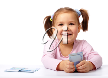 Royalty Free Photo of a Little Girl With Money
