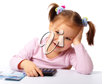 Royalty Free Photo of a Girl With Euros and a Calculator