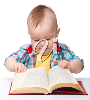 Royalty Free Photo of a Baby With a Book