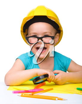 Royalty Free Photo of a Little Girl Wearing Glasses and a Hardhat