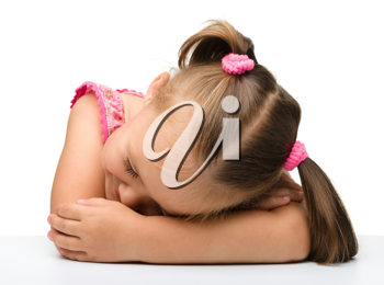 Royalty Free Photo of a Little Girl Sleeping on Her Arms