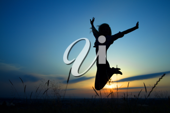 Royalty Free Photo of a Silhouette of a Girl Jumping