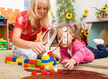 Royalty Free Photo of a Teacher and a Little Girl Playing