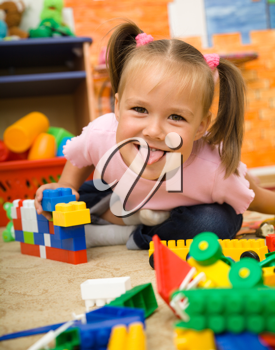 Royalty Free Photo of a Little Girl Playing With Building Bricks