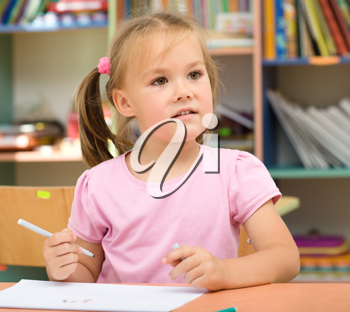 Royalty Free Photo of a Little Girl With a Marker