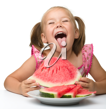 Cute little girl is gungy to eat watermelon, isolated over white