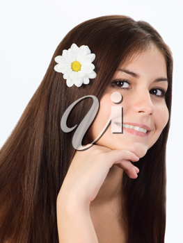 Royalty Free Photo of a Young Girl With a Flower in Her Hair