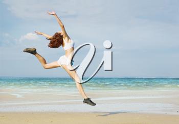 Royalty Free Photo of a Woman Running at the Beach
